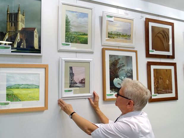 Chris Dodd with some of the work in our exhibition at Pershore Library