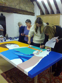 Pershore Arts members painting one of the library panels